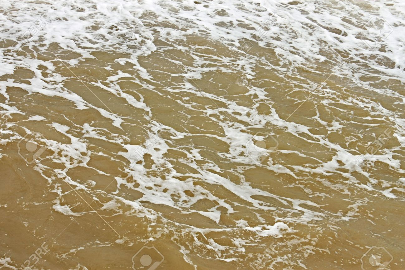 21132434-coastal-foamy-seawater-surface-after-the-storm-polluted-dredged-from-the-seabed-sand-stock-photo