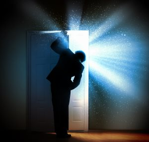 young-businessman-standing-with-back-opening-door