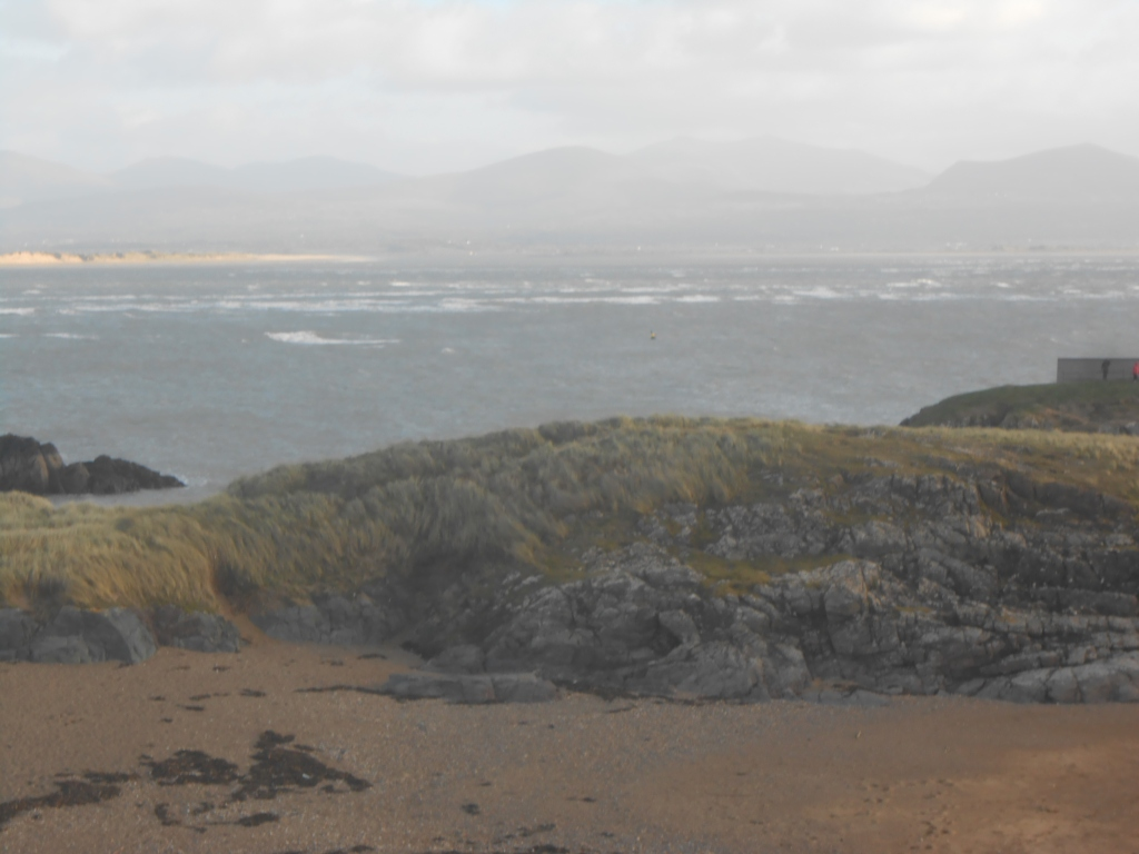 looking out to see from Ynys Llanddwyn listening to what the island is saying