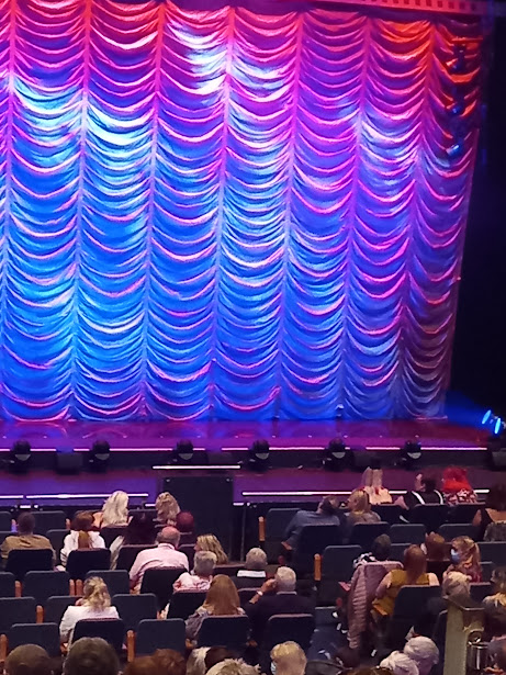 A blue curtain waiting to be raised in Theatre Cymru for the performance of The Rocky Horror Picture show. Taken by Diane Woodrow