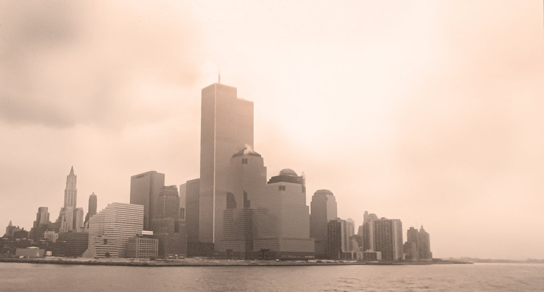 New York pre 9/11 with sun rising behind it